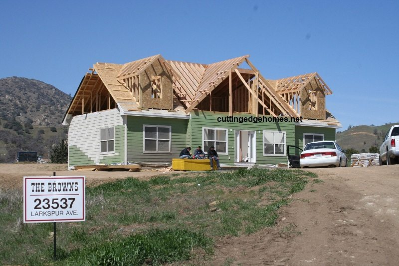 custom-cape-house-in-rough-roof-framing