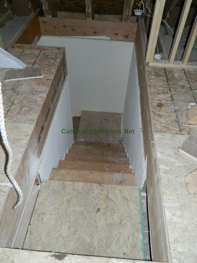Highland Cape with Unfinished Attic: Interior 3 Weeks After Delivery - Unfinished Attic Stairs Down